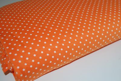 Jersey pois blancs fond orange oko tex - par 50 cm